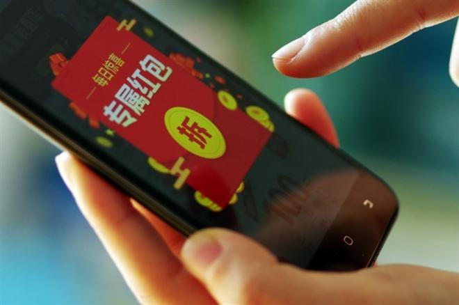 Nền tảng WeChat cung cấp tính năng lì xì trực tuyến. (Ảnh: Caixin)