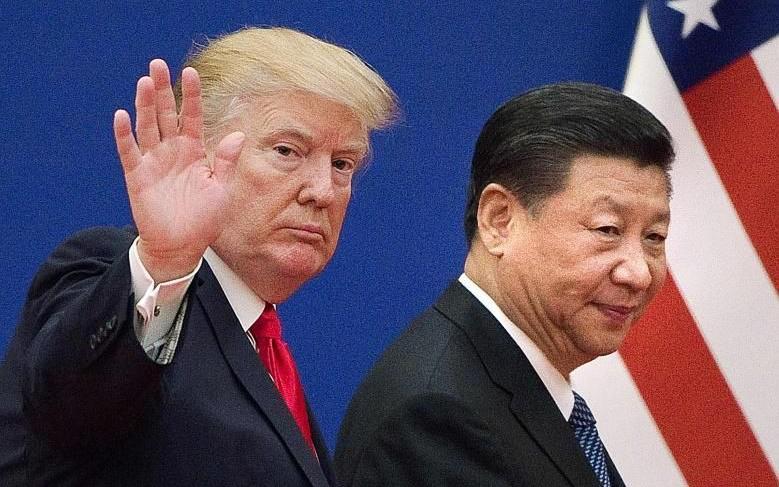 """""""Cuộc chiến thương mại không hồi kết"""" Mỹ-Trung. Ảnh: AFP"""