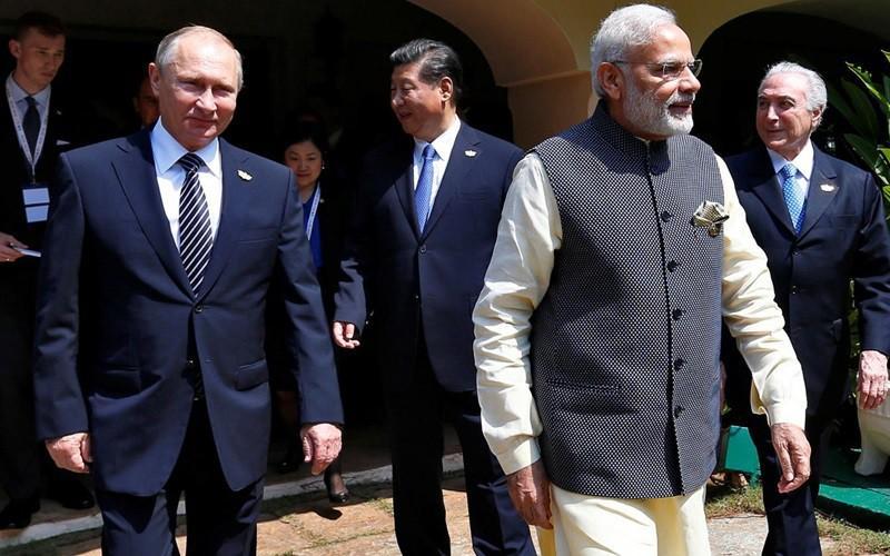 Các nhà lãnh đạo Nga (Putin), Trung Quốc (Tập), và Ấn Độ (Modi). Ảnh: Reuters.