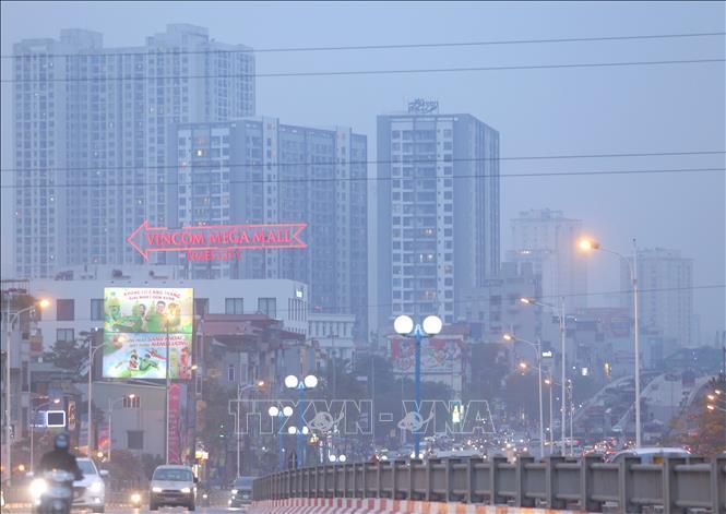 Nhiều khu vực tại Hà Nội chìm trong làn sương và bụi mịn ngày 16/1/2021.