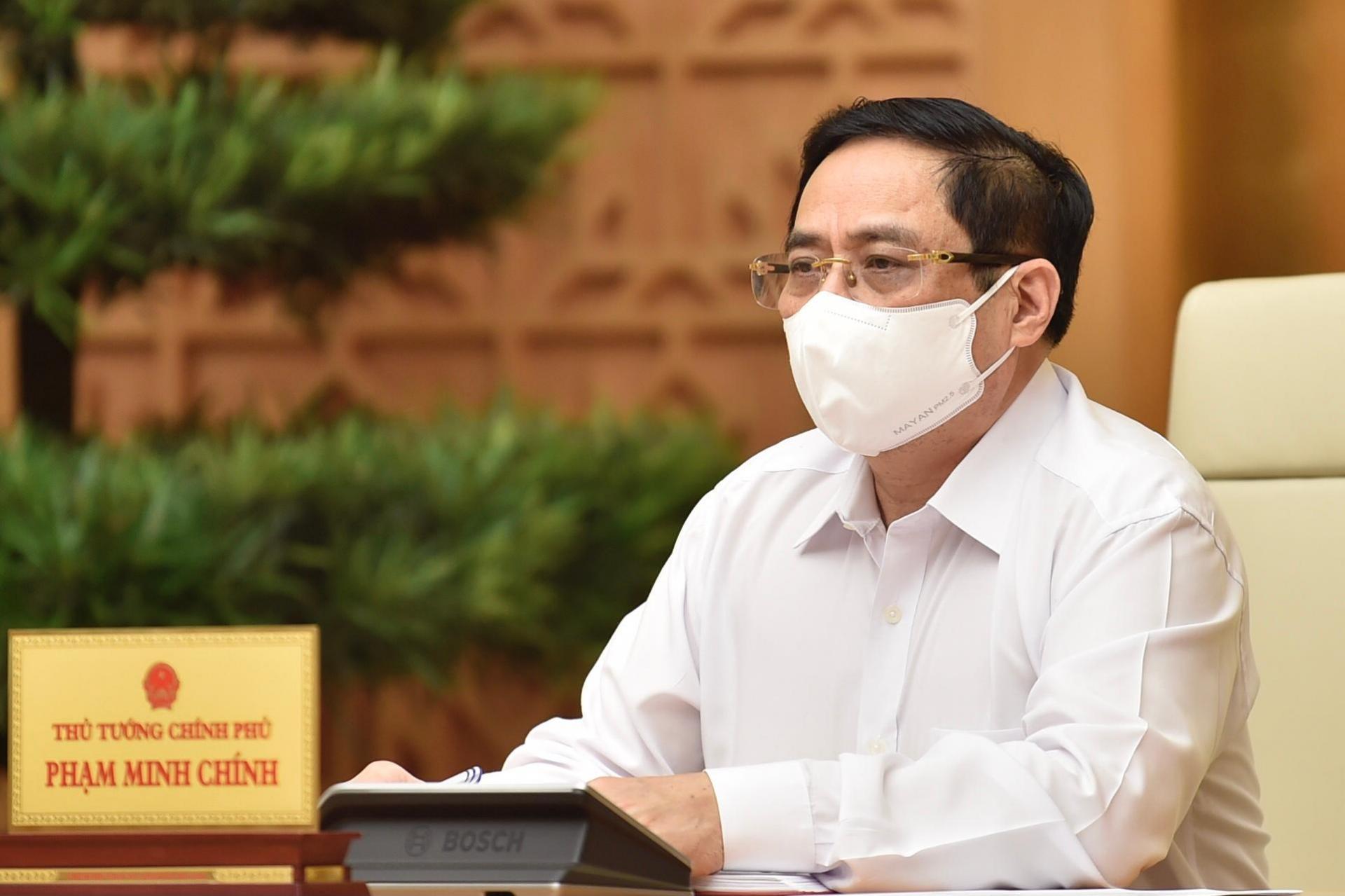 Thủ tướng Chính phủ Phạm Minh Chính triệu tập cuộc họp trực tuyến với tỉnh Bắc Giang, Bắc Ninh và các lực lượng chống dịch tại địa phương này - Ảnh: VGP