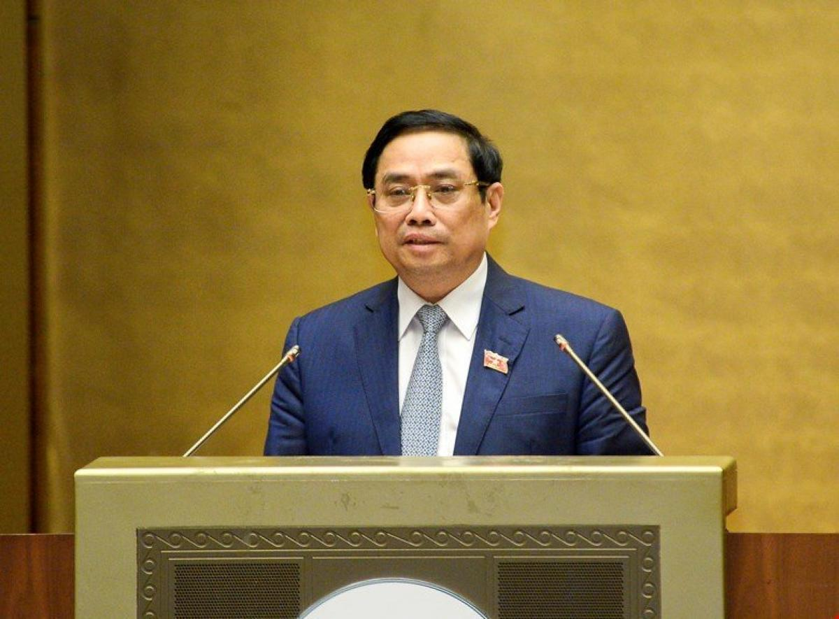 Thủ tướng Chính phủ Phạm Minh Chính trình bày tờ trình trước Quốc hội sáng 22/7